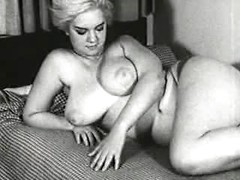 Old-time blonde demonstrates her nude body and big melons
