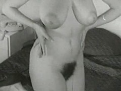 Busty short-haired mom shows furry cunt and huge tits
