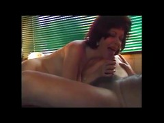 Curly lady sucking off cock in this retro porn video
