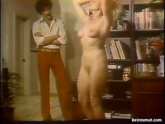 Classic 70s porn scene with a hot blonde babe in tight jeans stripping for her man